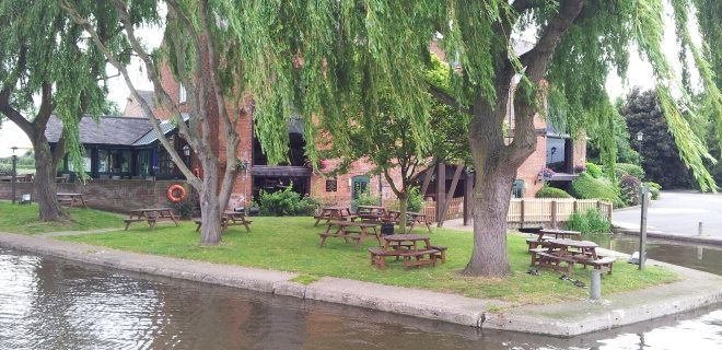 Canal-Side Pub with Seating