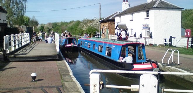 Two Canalboats Entering Lock in England